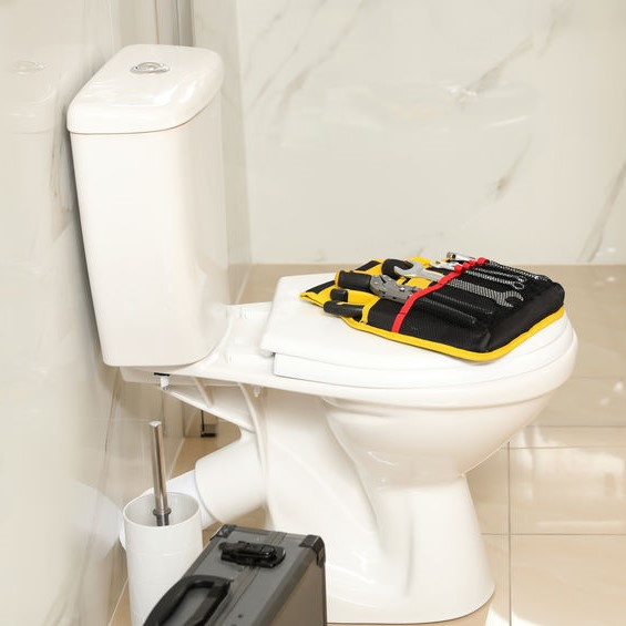 toilet being repaired