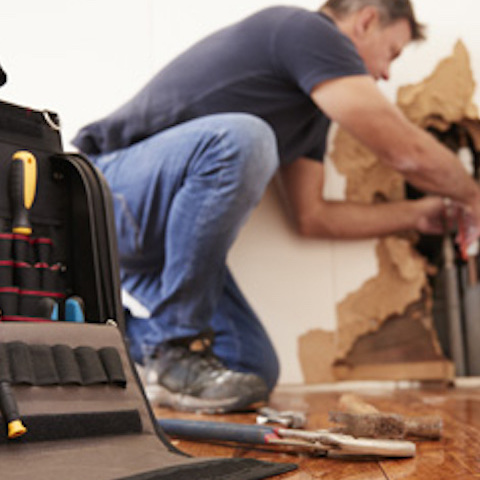 Plumber administering emergency plumbing services